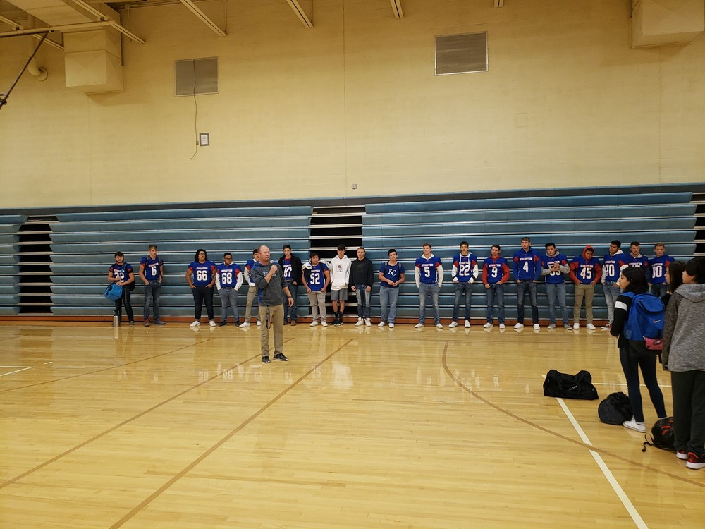 HHS Football team at HMS Fight song Friday